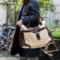 Andrea travel bag in ecru canvas and chocolate leather