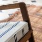 Gloria fireside chair brown wood, striped black and beige Dedar fabric